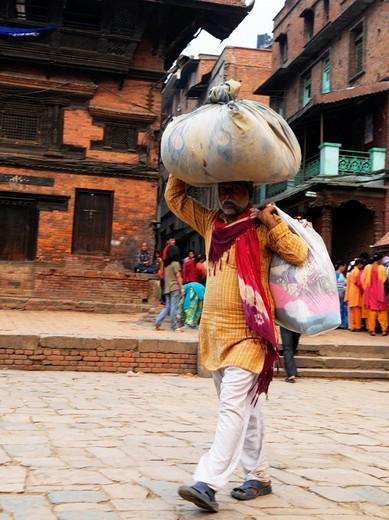 Stock Photo: 1566-810357 homeless man with his belongings , the nepalis , life in kathmandu , kathmandu street life , nepal