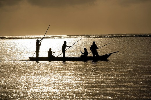 Fisherman at sunrise - Diani Beach - near Mombasa, Kenya : Stock Photo