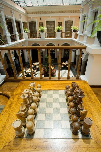 Stock Photo: 1566-811204 Chess Set and Atrium at Hotel Patio Andaluz - Quito, Ecuador