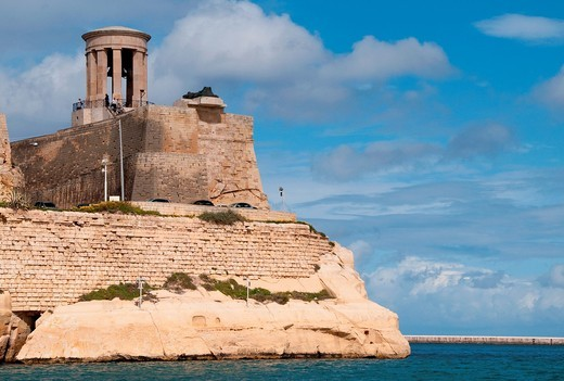 The Seige Bell memorial on an outcrop of the Grand Harbour, Valletta, Malta : Stock Photo