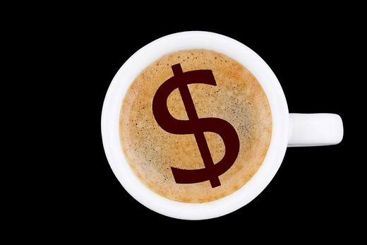 digital enhancement - clip image - dollar icon on cafe crema coffee foam - symbolism for currency dependence on commodities : Stock Photo