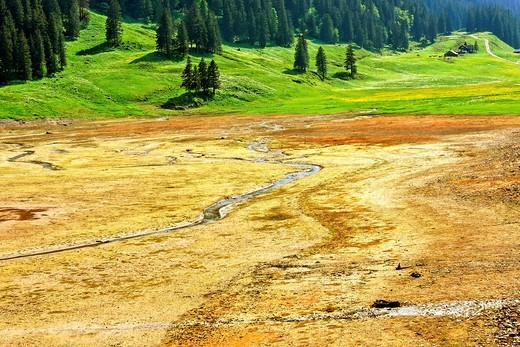 dry lake samtisersee after less precipitation in winter and spring - canton of appenzell-innerrhoden - switzerland : Stock Photo