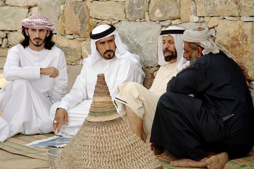 Stock Photo: 1566-813695 United Arab Emirates, Dubai, group of men talking