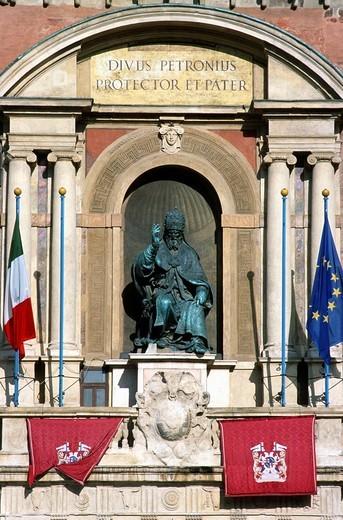 Italy, Emilia Romagna, Bologna, Piazza Maggiore, statue, flags, : Stock Photo