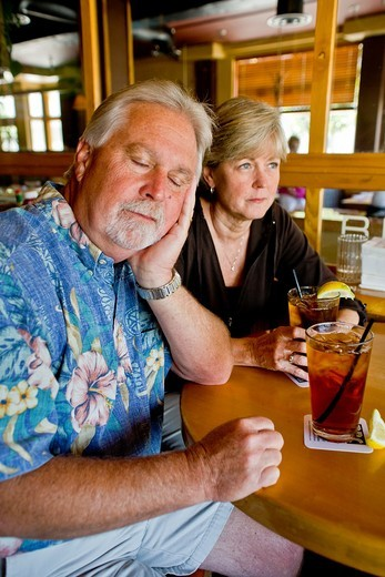 Stock Photo: 1566-816569 A middle aged couple appeared indifferent to each others´ company over iced tea together in a Long Beach, CA, restaurant