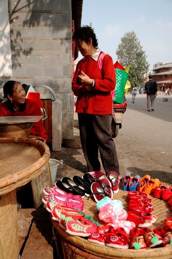 Stock Photo: 1566-817504 Traditional style hand made embroidered shoes for sale on old town street  Town of Guandu  Kunming  China