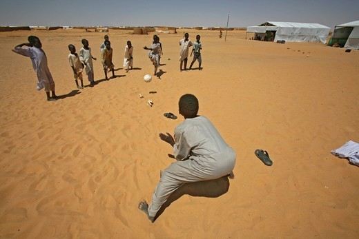 sudanese refugee children playing with self made toys : Stock Photo