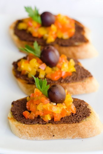 Three Bruschettas with peppers and olives, finger food : Stock Photo