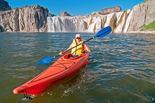 kayaking The Snake River below Shoshone Falls deep in the Snake River Canyon near the city of Twin Falls in southern Idaho : Stock Photo