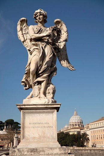 Angel by Bernini on the Ponte Sant´Angelo bridge and St  Peter´s Basilica in Rome, Lazio, Italy, Europe : Stock Photo