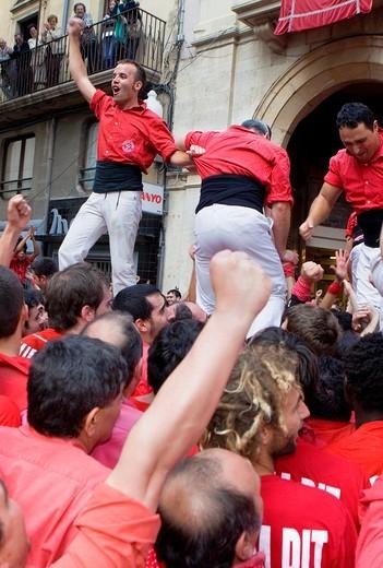 Stock Photo: 1566-826755 Celebrating a great success Colla Joves Xiquets de Valls ´Castellers´ is a Catalan tradition Fira de Santa Úrsula Valls  Tarragona province, Spain