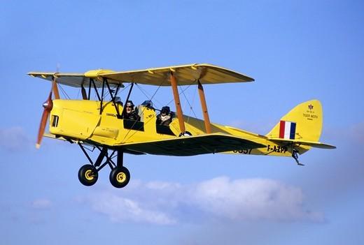 Stock Photo: 1566-827847 Old British trainer biplane De Havilland DH-82c Tiger Moth in flight over France