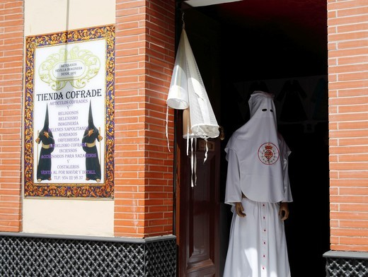 Cofrade shop in Seville selling robes and hats for Semana Santa processions  Andalusia, Spain : Stock Photo