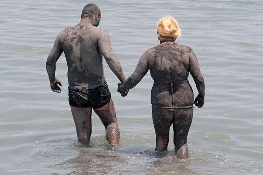 Stock Photo: 1566-828173 Couple cover themselves in mud from Lo Pagan beach, believed to have beneficial properties for the skin, Lo Pagan, Region of Murcia, South Eastern Spain