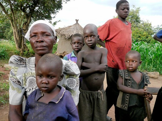 UGANDA  Acupu Alice, 20, former abductee of LRA, with her baby and extended family  Lira : Stock Photo