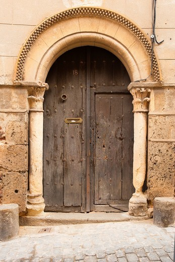 In the district of Segovia Canonjías, so called because originally the residence of the canons in Segovia, we can find some of the few examples of Romanesque civil architecture in Spain : Stock Photo