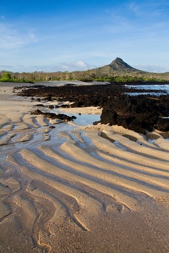 Wave-caused patterns on the beach at Cerro Dragon in the Galapagos Island Archipelago, Ecuador : Stock Photo