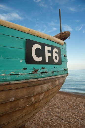 Detail of wooden fishing boat on the beach, known as the Stade, at Hastings, East Sussex, England, UK : Stock Photo