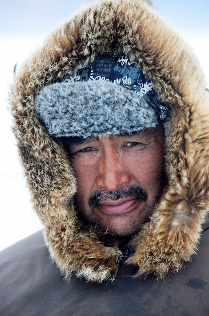 Stock Photo: 1566-833945 Portrait of Inuit hunter with a fur hat, Floe Edge, Arctic bay, Baffin Island, Nunavut, Canada