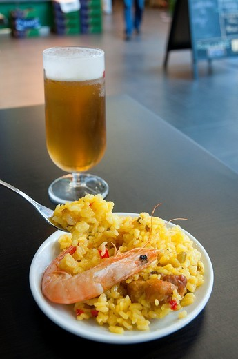 Paella valenciana and glass of beer. Madrid, Spain. : Stock Photo