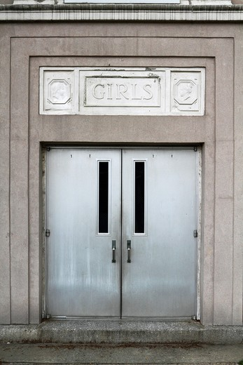 Stock Photo: 1566-834884 A door to Public School No  13 in Clifton, New Jersey, USA  While the school is still in use the doors harken back to a bygone era in which girls and boys entered the building through separate doors