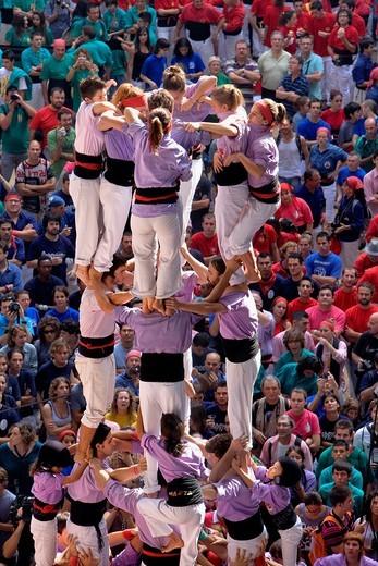 Stock Photo: 1566-834917 Colla Jove Xiquets de Tarragona ´Castellers´ building human tower, a Catalan tradition Biannual contest  bullring Tarragona, Spain