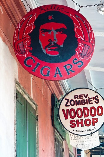 Signs along the street in the French Quarter of New Orleans : Stock Photo