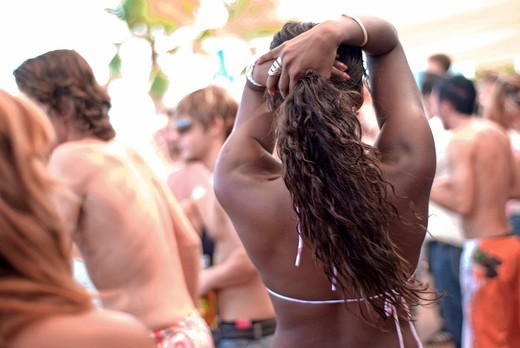 People of all ages dancing non stop during the day at popular club Bora Bora, Ibiza, Spain : Stock Photo