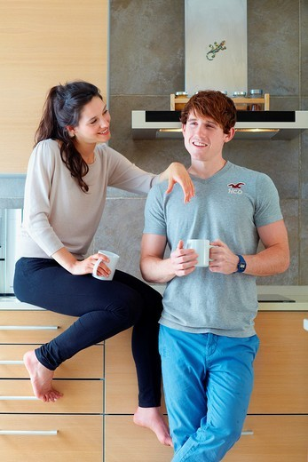 Young couple in kitchen : Stock Photo