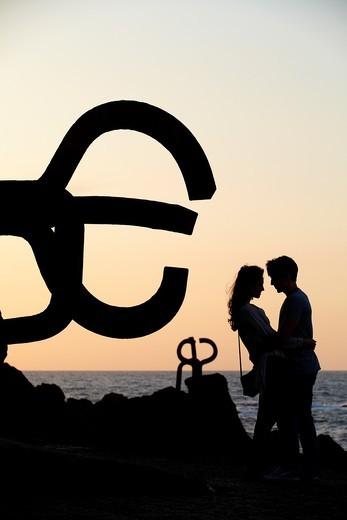 Couple in Peine del viento, by Eduardo Chillida, Donostia, San Sebastian, Gipuzkoa, Euskadi, Spain : Stock Photo
