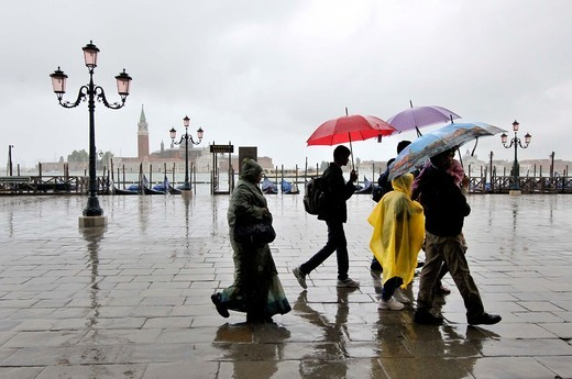Stock Photo: 1566-838739 People with umbrellas on a rainy day, from the Doge´s Palace,  Riva degli Schiavoni. Venice, Veneto, Italy.