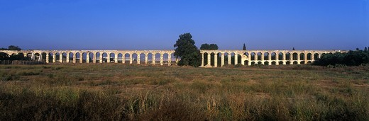 Stock Photo: 1566-838943 OLD OTTOMAN TURKISH AQUADUCT LOHAMEI HAGETAOTT KIBBUTZ ACCO ISRAEL