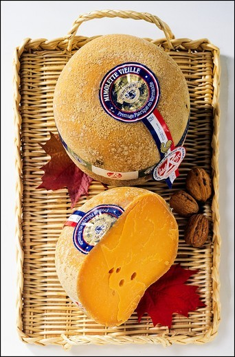 Stock Photo: 1566-840739 Whole Mimolette French cheese and wedge on wicker tray