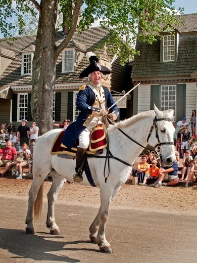Stock Photo: 1566-840786 Mounted on a horse, an actor dressed as the Marquis de Lafayette reenacts a speech by the Revolutionary War hero in Colonial Williamsburg, VA, an assemblage of buildings populated with historical reenactors who demonstrate aspects of daily life in the pas. Mounted on a horse, an actor dressed as the Marquis de Lafayette reenacts a speech by the Revolutionary War hero in Colonial Williamsburg, VA, an assemblage of buildings populated with historical reenactors who demonstrate aspects of daily lif