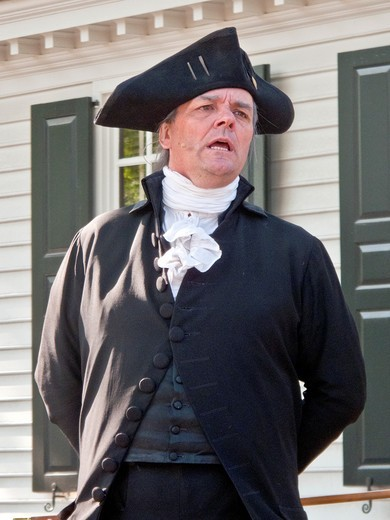 Stock Photo: 1566-840788 An actor portraying George Washington delivers a speech outside the Raleigh Tavern in Colonial Williamsburg, VA, a ´living history´ museum with an assemblage of buildings populated with historical reenactors who work, dress, and talk as in colonial times