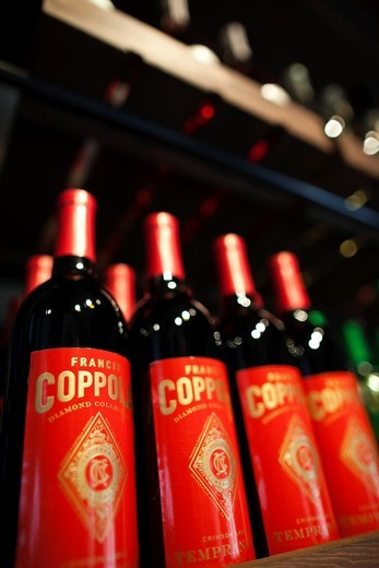 Stock Photo: 1566-842037 USA, California, Northern California, Russian River Wine Country, Geyserville, Francis Ford Coppola Winery, wine bottles