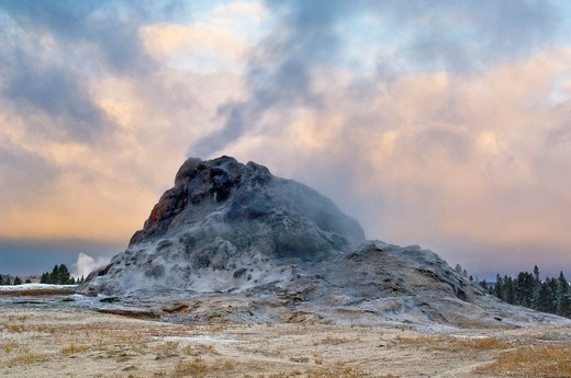 Stock Photo: 1566-842579 Steam venting from White Dome Geyser and autumn storm clouds at sunrise, Yellowstone National Park, Wyoming