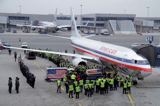 New York, New York City, NYC, Brooklyn, John F  Kennedy International Airport, JFK, American Airlines, company, US carrier, aircraft, ground crew, loading casket, dead soldier, military ceremony, American flag, pay respect, honor, solemn, : Stock Photo