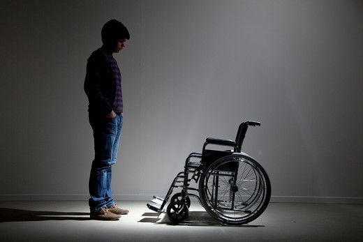 Stock Photo: 1566-844541 Man and wheelchair