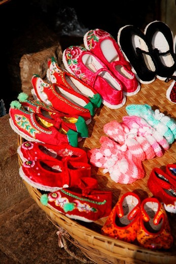 Stock Photo: 1566-845629 Traditional style hand made embroidered shoes for sale on old town street  Town of Guandu  Kunming  China