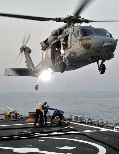Stock Photo: 1566-845943 ATLANTIC OCEAN July 29, 2011 An SH-60 Sea Hawk helicopter assigned to the Dragon Whales of Helicopter Sea Combat Squadron HSC 28 practices landing sequences during deck landing qualifications aboard the guided-missile destroyer USS Ross DDG 71