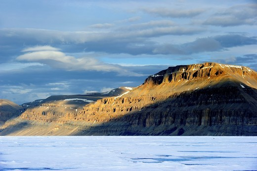 Midnight sun light over icepack and cliffs in spring, Arctic Bay, Baffin Island, Nunavut, Canada : Stock Photo