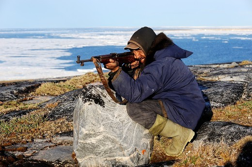 Inuit hunter with gun, Igloolik, Foxe Basin, Nunavut, Canada : Stock Photo