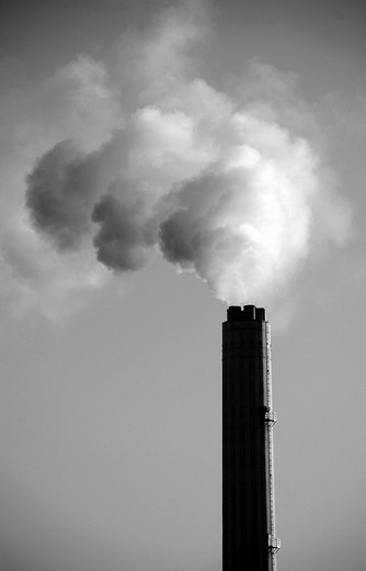 Smoke rises from an industrial chimney : Stock Photo
