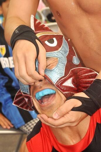 Stock Photo: 1566-847165 Naha (Japan): wrestling show at the Dragon Boat Festival