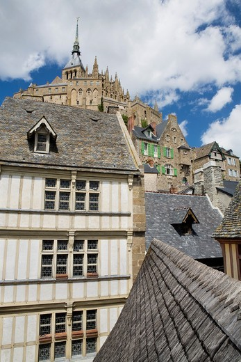 Typical and old houses under Mont-Saint Michel abbey, listed as World Heritage by UNESCO, Manche department, Lower Normandie region, France : Stock Photo