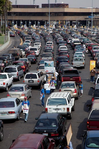 Tijuana, Mexico - Cars wait in long lines to cross the U S -Mexico border into California : Stock Photo