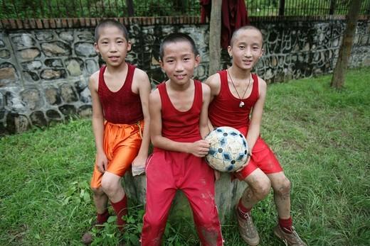 young Tibetan Monks playing footbaal in Kathmandu, Nepal : Stock Photo