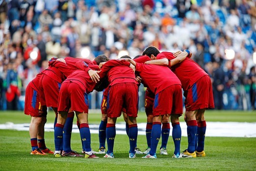 FC Barcelona players hugging before the UEFA Champions League Semifinals game between Real Madrid and FC Barcelona, Bernabeu Stadiumn, Madrid, Spain : Stock Photo