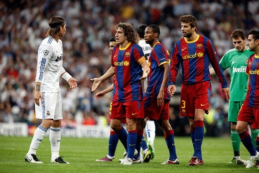 Stock Photo: 1566-851293 Sergio Ramos arguing with Puyol, UEFA Champions League Semifinals game between Real Madrid and FC Barcelona, Bernabeu Stadiumn, Madrid, Spain